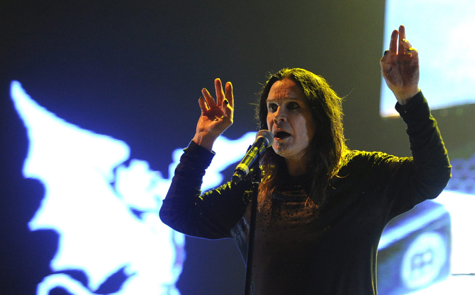 epa04259948 Singer Ozzy Osbourne of the English Heavy Metal Band 'Black Sabbath' on the Blue Stage stage during a concert at
