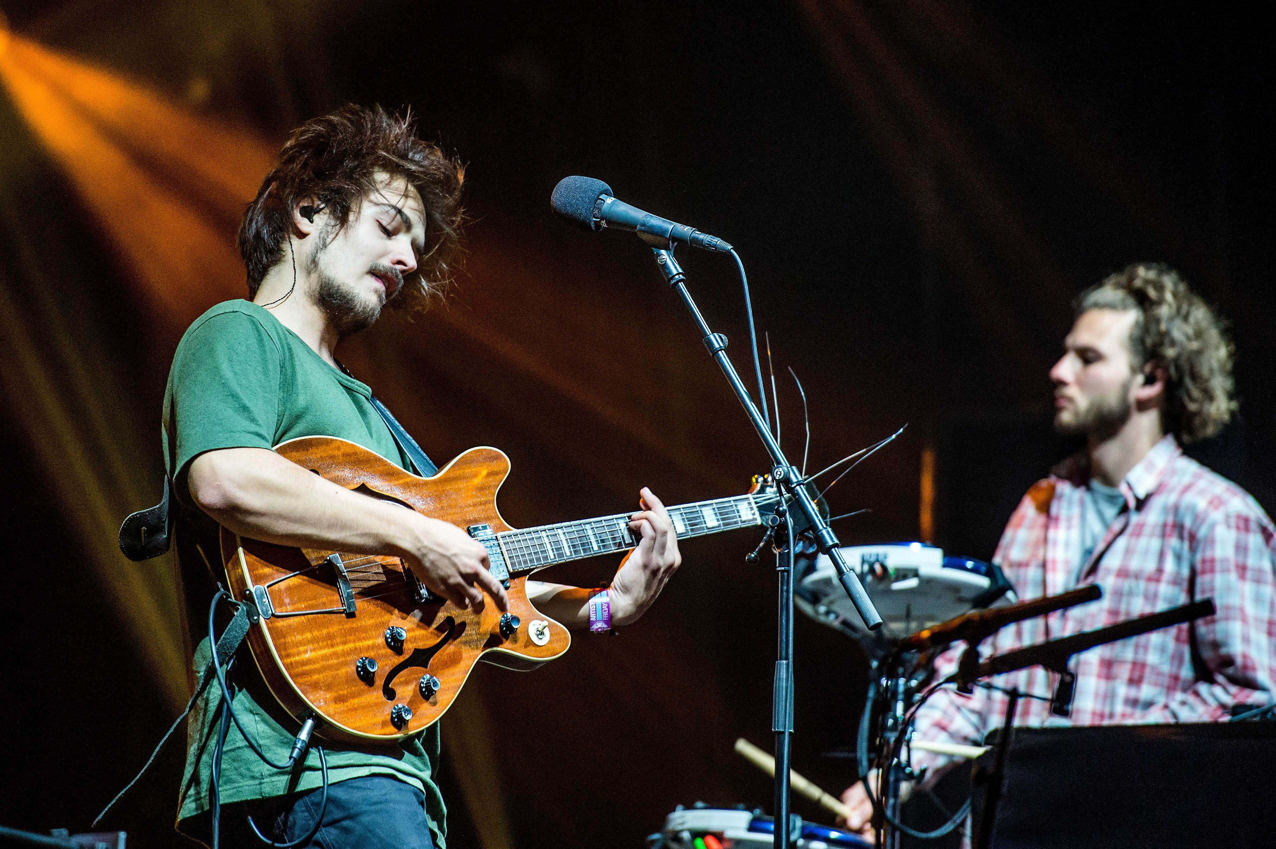 epa04355451 Singer and guitarist Clemens Rehbein (L) of German formation Milky Chance performs on stage during the Lowlands m