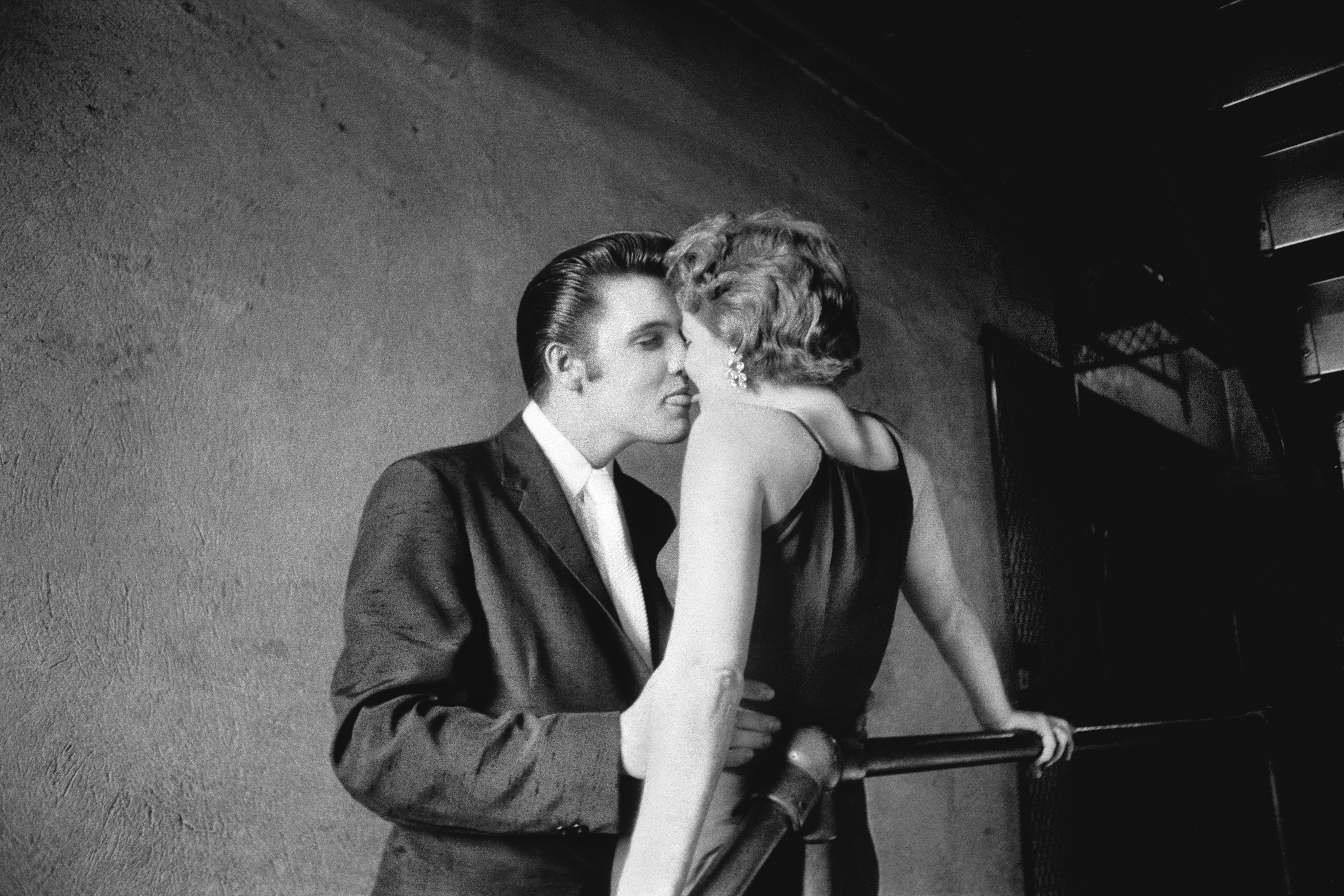 This June 30, 1956 photo provided by courtesy of Taschen shows, 'The Kiss,' at the Mosque Theater in Richmond, Va. The image