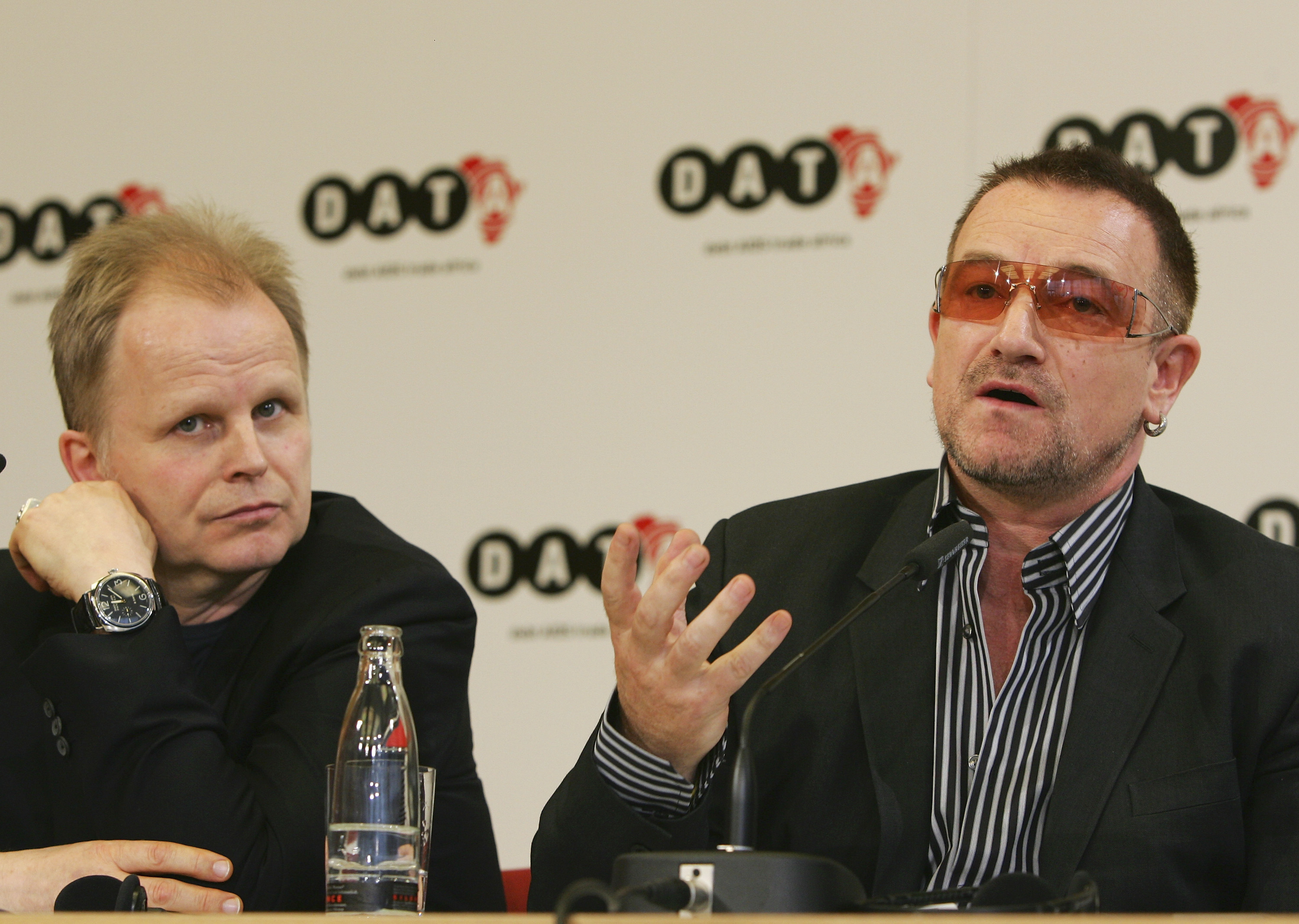 BERLIN - MAY 15:  Musicians Bono (R) and Herbert Groenemeyer speak during a news conference after the presentation of DATA (D