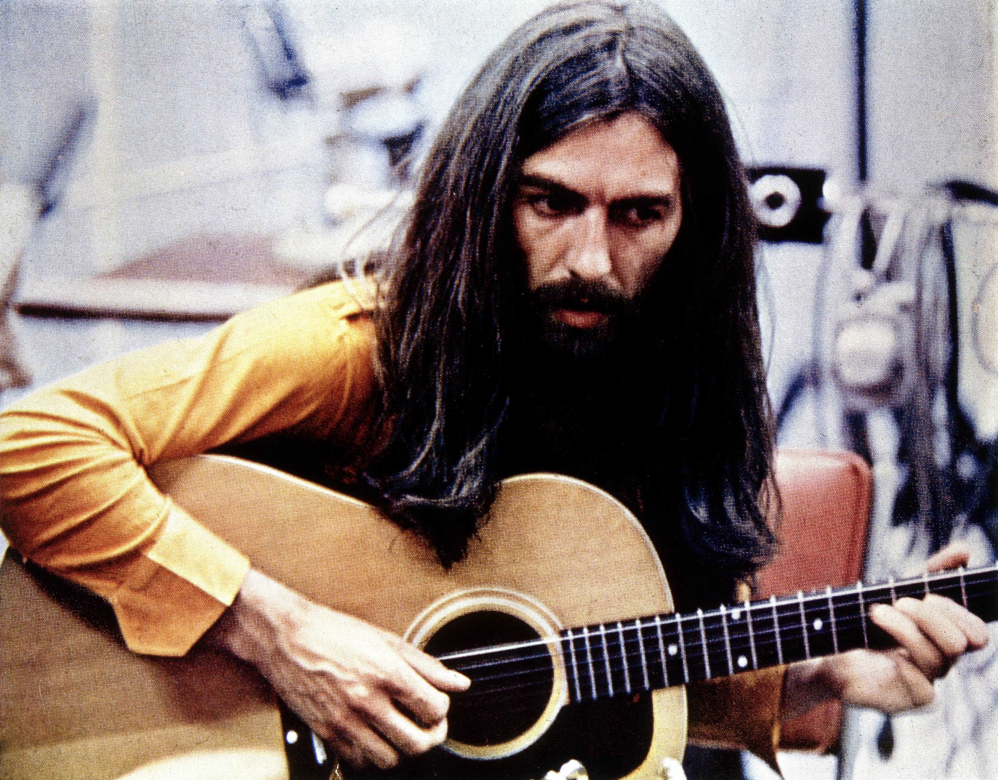 UNSPECIFIED - JANUARY 01:  (AUSTRALIA OUT) Photo of George HARRISON; playing acoustic guitar, c.1970/1971  (Photo by GAB Arch