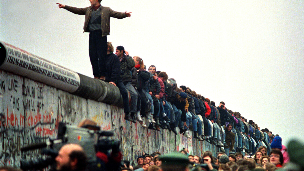 WEST BERLIN - NOVEMBER 11: People stand on a section of the Berlin Wall at Potsdamer Platz. (Photo by John Tlumacki/The Bosto