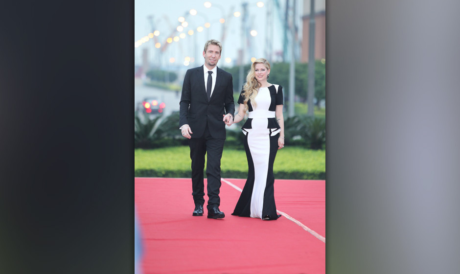 MACAU - OCTOBER 07:  (CHINA OUT) Singer Avril Lavigne and her husband Chad Kroeger attend the 2013 Huading Awards ceremony at