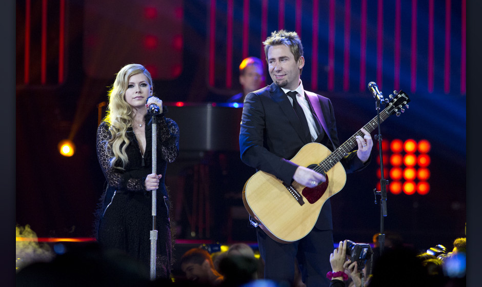 VANCOUVER, BC - OCTOBER 18:  Grammy Award nominated and winning couple Avril Lavigne and Chad Kroeger perform at We Day Vanco
