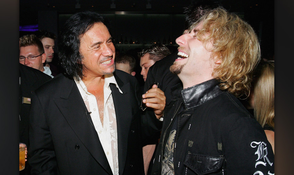 LAS VEGAS - AUGUST 25:  Nickelback frontman Chad Kroeger (R) shares a laugh with Kiss singer/bassist Gene Simmons during Simm