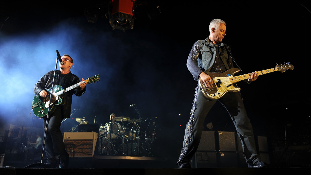 (L-R) Lead singer Bono and bassist Adam Clayton of U2 perform during the U2360 Tour at Soldier Field on September 12, 2009 in