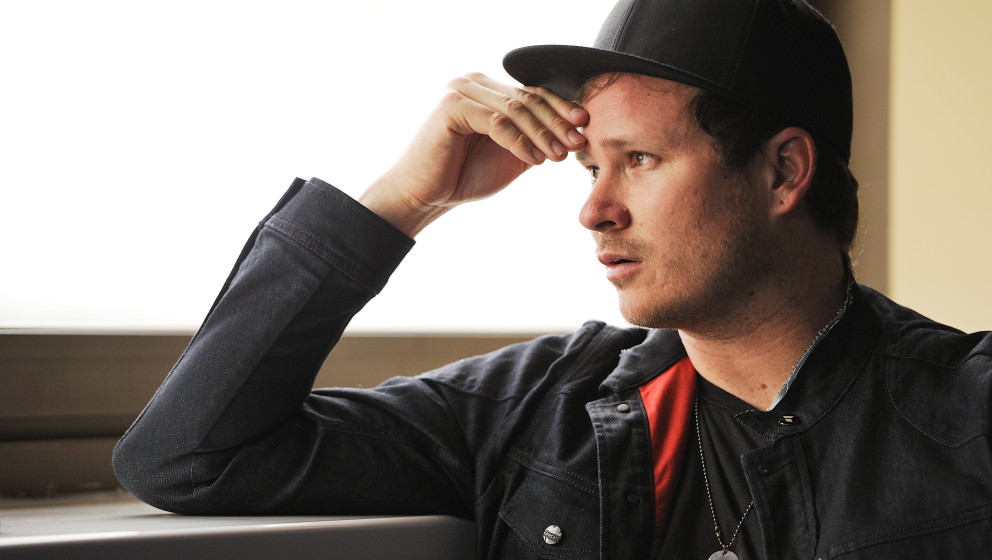 CARDIFF, UNITED KINGDOM - JULY 10: Tom DeLonge, guitarist and vocalist of American pop punk band Blink-182, photographed duri