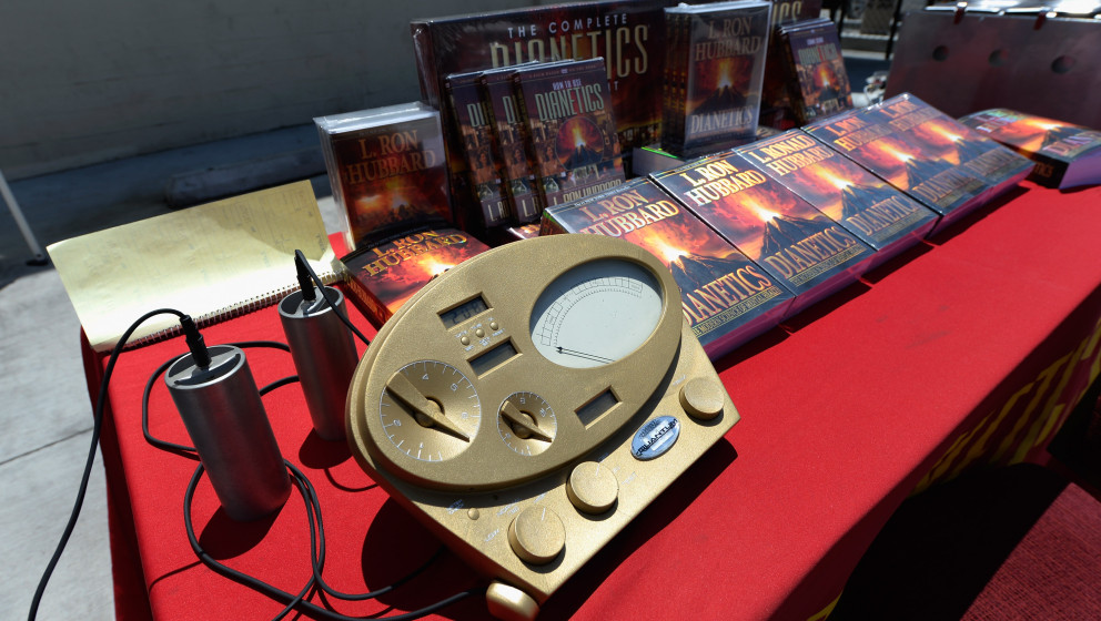 LOS ANGELES, CA - JUNE 05:  The Scientology E-Meter and cans are show along with books by L. Ron Hubbard, founder of Chruch o
