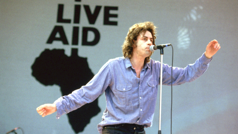 Bob Geldorf and the Boomtown Rats performing live at the Live Aid Concert, Wembley Stadium, London on 13th July 1985.;  (Phot