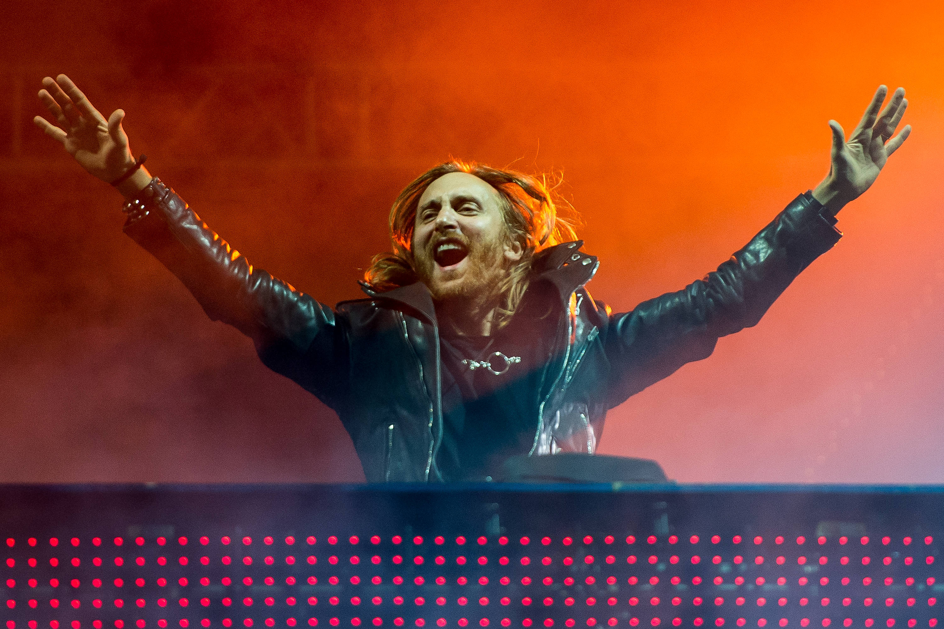 RIO DE JANEIRO, BRAZIL - SEPTEMBER 13: DJ David Guetta performs on stage during a concert in the Rock in Rio Festival on Sept