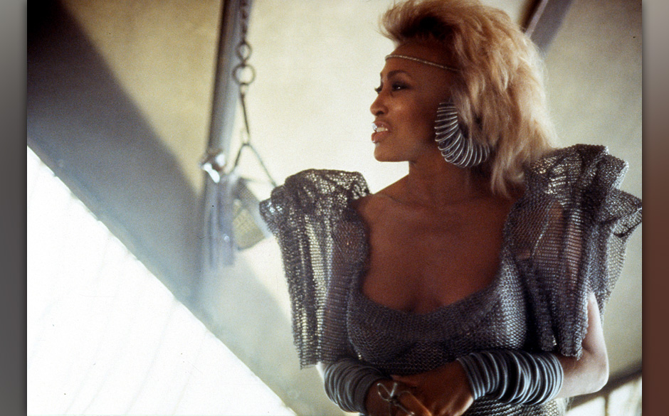 Tina Turner wearing silver attire in a scene from the film 'Mad Max Beyond Thunderdome', 1985. (Photo by Warner Brothers/Gett