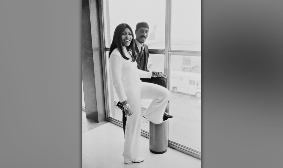 American musician Ike Turner (1931 - 2007) and his wife, singer, dancer, and actress Tina Turner at London Airport on their w