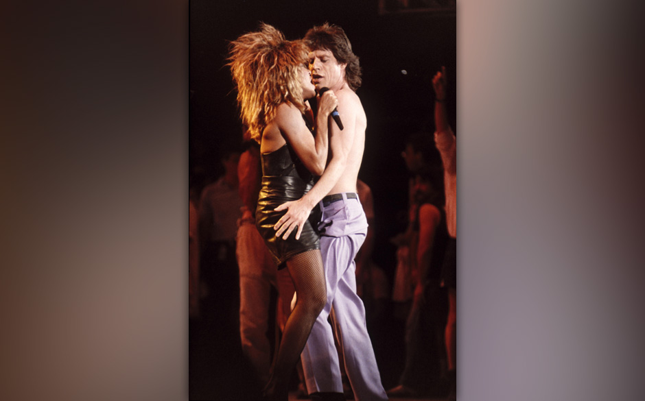 UNITED STATES - JULY 13:  LIVE AID  Photo of Tina TURNER and Mick JAGGER, Tina Turner and Mick Jagger performing on stage at
