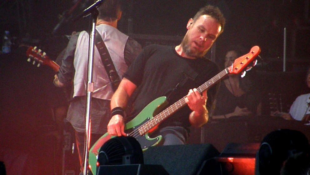 MILTON KEYNES, UNITED KINGDOM - JULY 11: Jeff Ament of Pearl Jam performs on stage at Milton Keynes Bowl on July 11, 2014 in