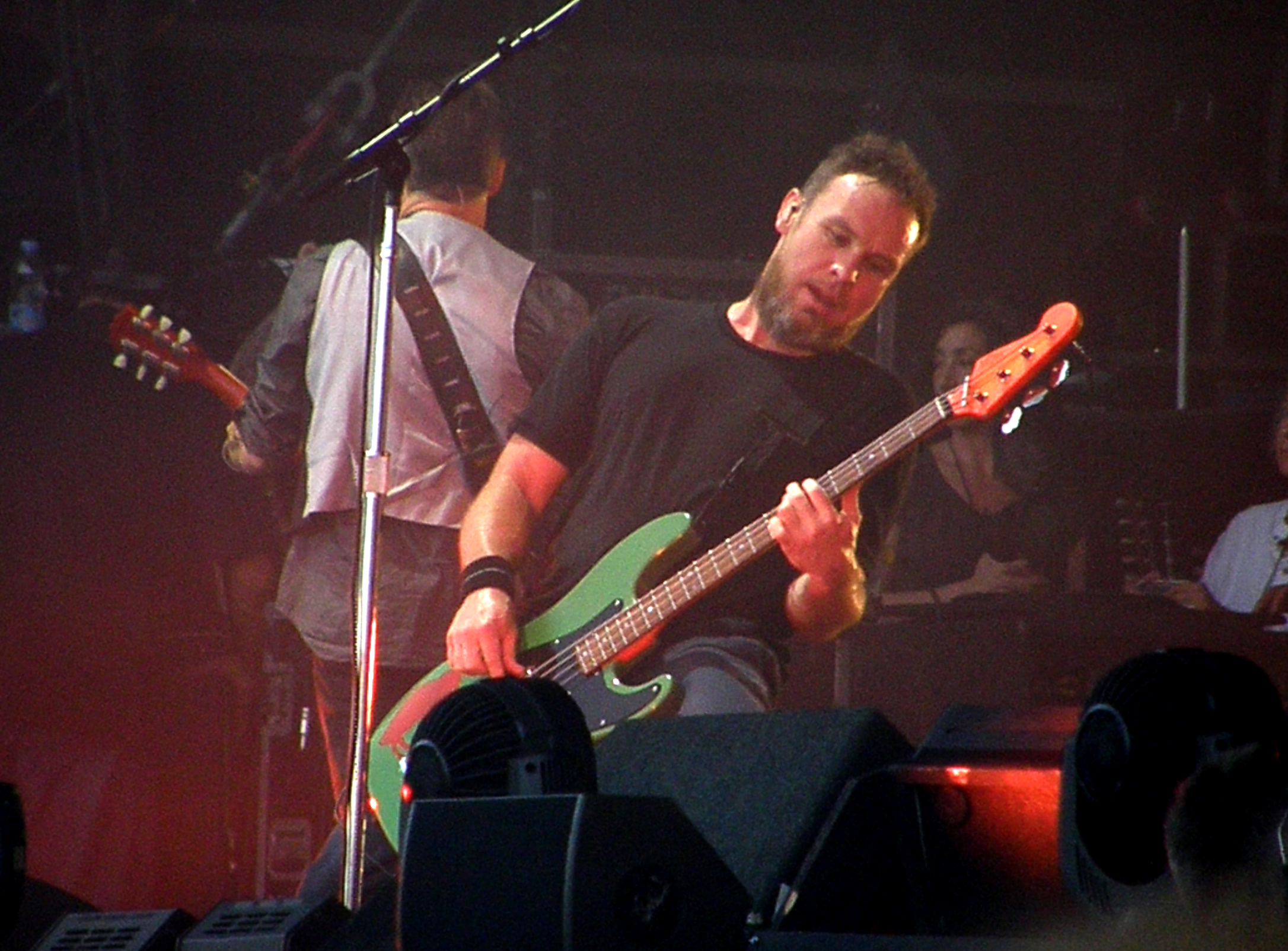 MILTON KEYNES, UNITED KINGDOM - JULY 11: Jeff Ament of Pearl Jam performs on stage at Milton Keynes Bowl on July 11, 2014 in