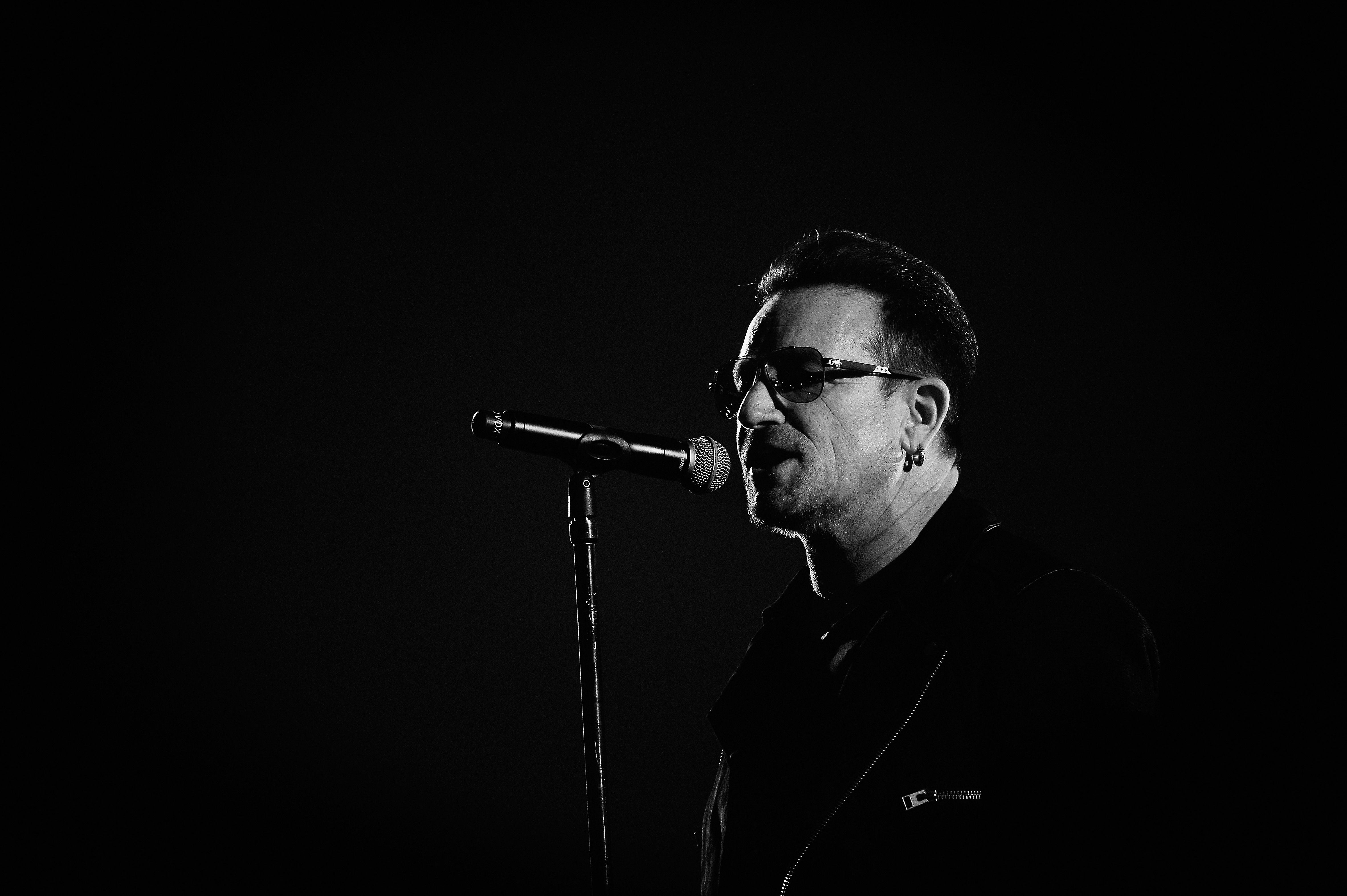 GLASGOW, SCOTLAND - NOVEMBER 09: (EDITORS NOTE: Image has been converted to black and white)  An alternative view of Bono of