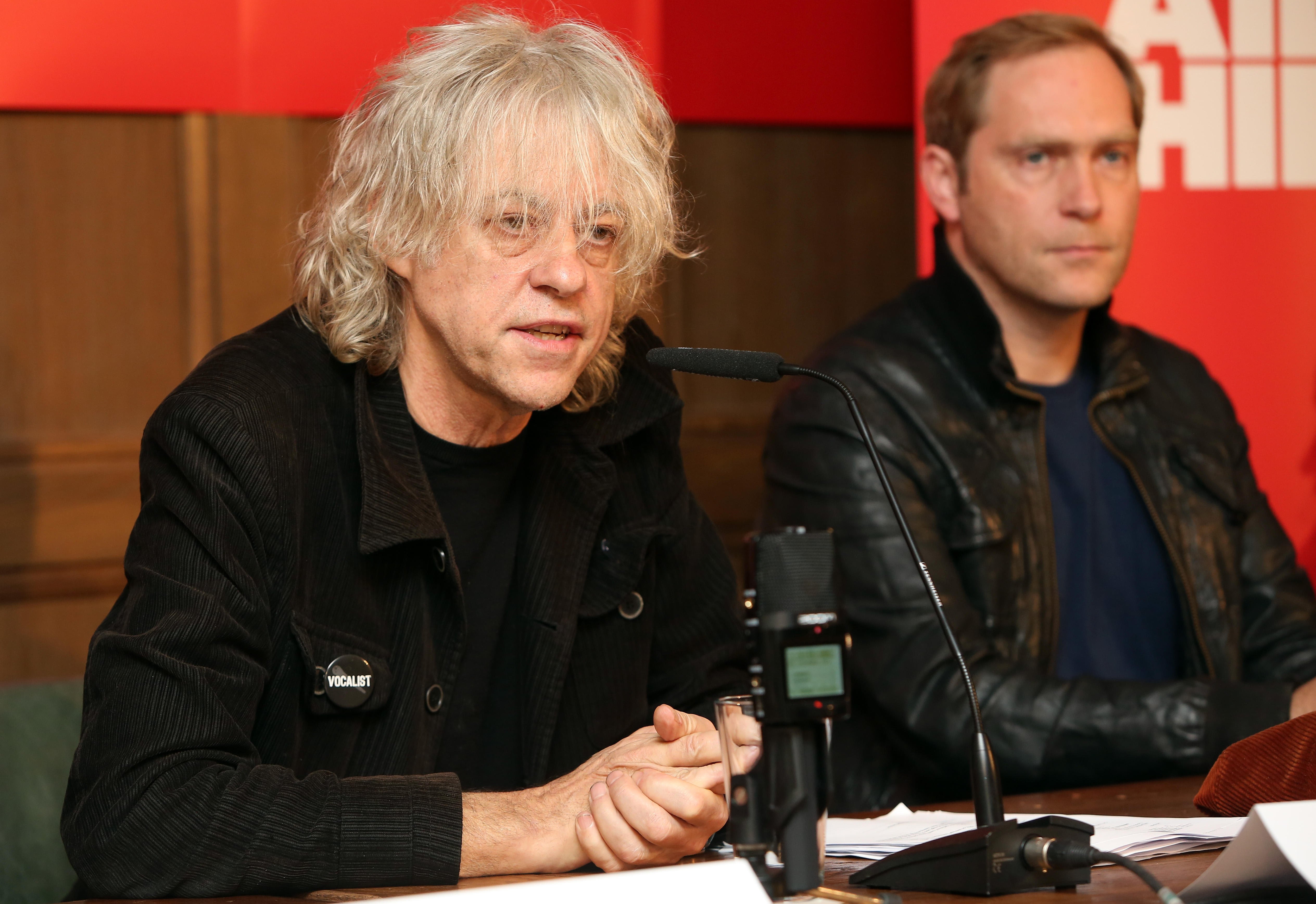 BERLIN, GERMANY - NOVEMBER 13: Irish Singer Bob Geldof (L) and German Singer Thees Uhlmann attend a press conference about th
