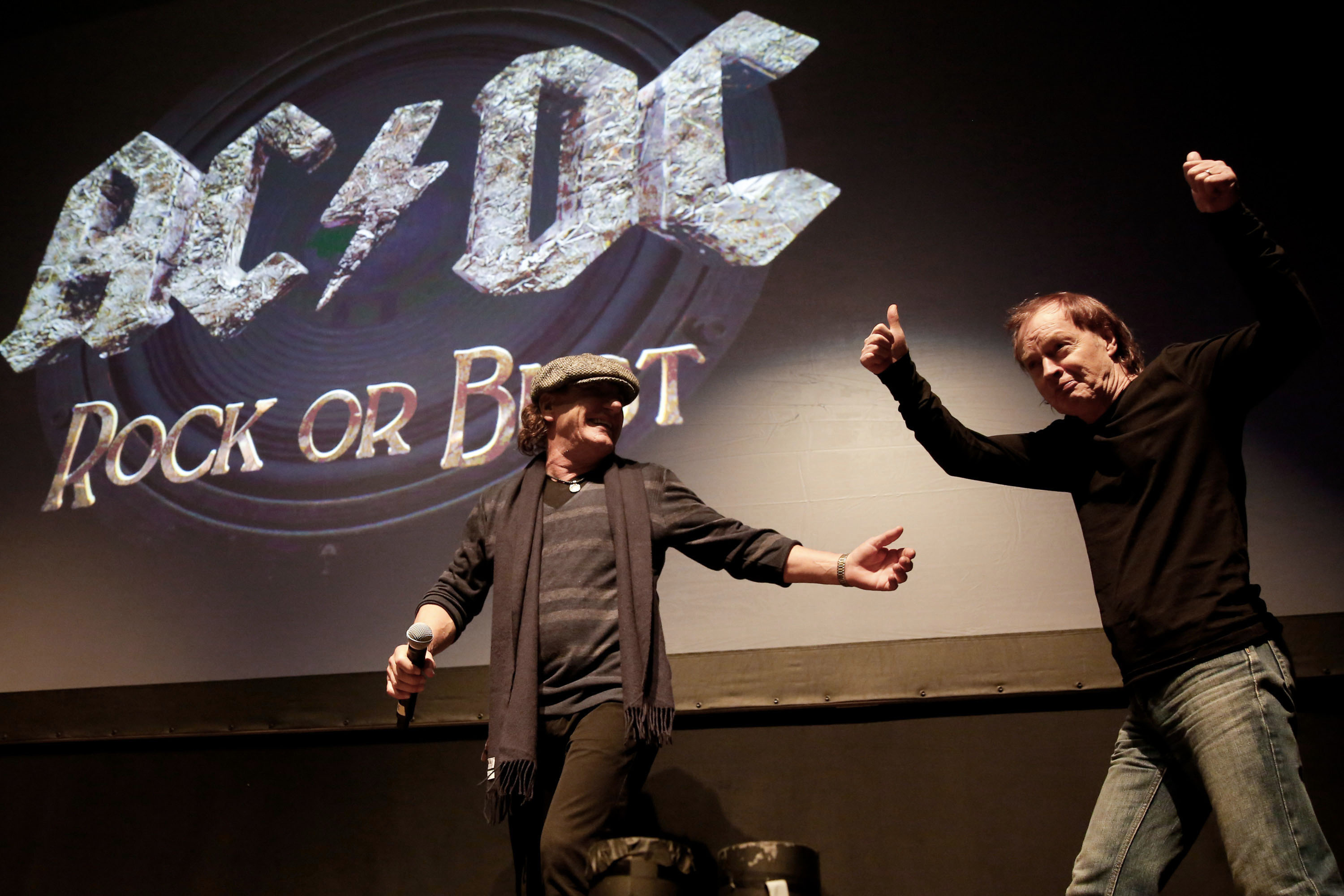 NEW YORK, NY - NOVEMBER 18:  (L-R) Singer Brian Johnson and guitarist Angus Young of the band AC/DC attend the AC/DC 'Rock or