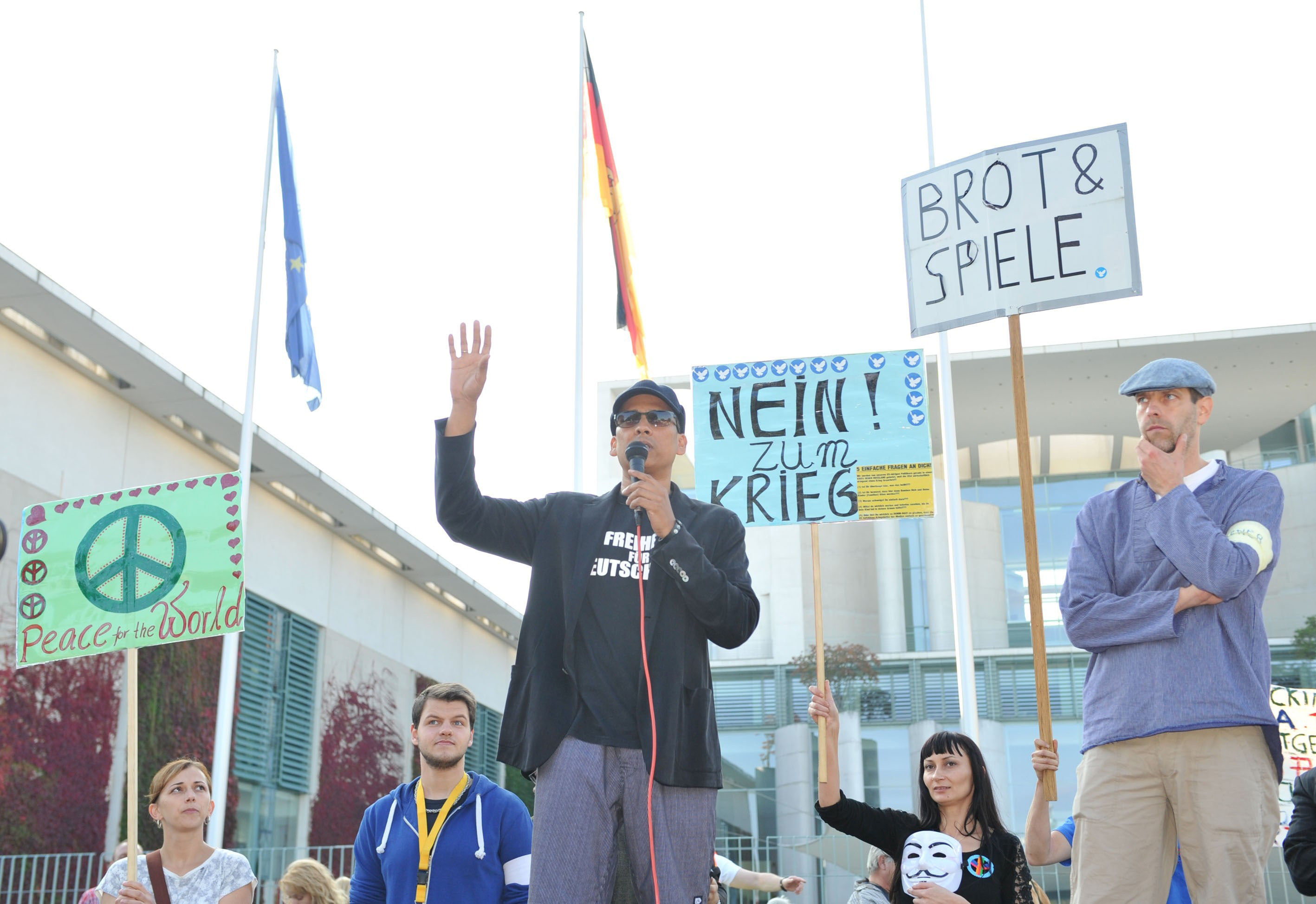 BERLIN, GERMANY - OCTOBER 3:  German Singer Xavier Naidoo speaks when a group of Germans gather outside the prime ministry to