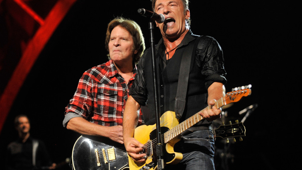 NEW YORK - OCTOBER 29:  John Fogerty and Bruce Springsteen performs on stage for the 25th Anniversary Rock & Roll Hall of
