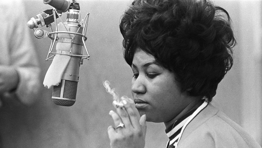MUSCLE SHOALS, AL - JANUARY 9: Singer Aretha Franklin smokes as cigarette as she works in the studio by a microphone at Muscl