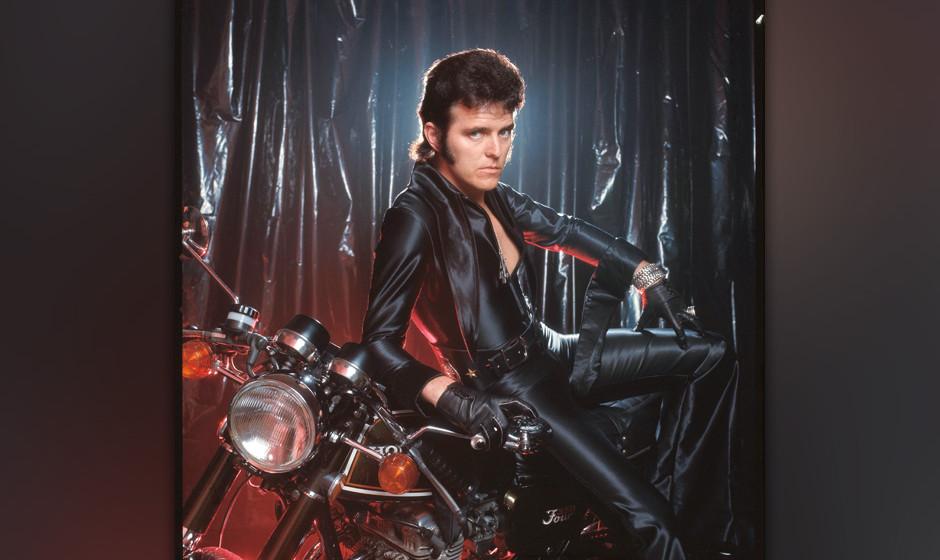Alvin Stardust, studio portrait,on motorbike, London, 1975. (Photo by Michael Putland/Getty Images)