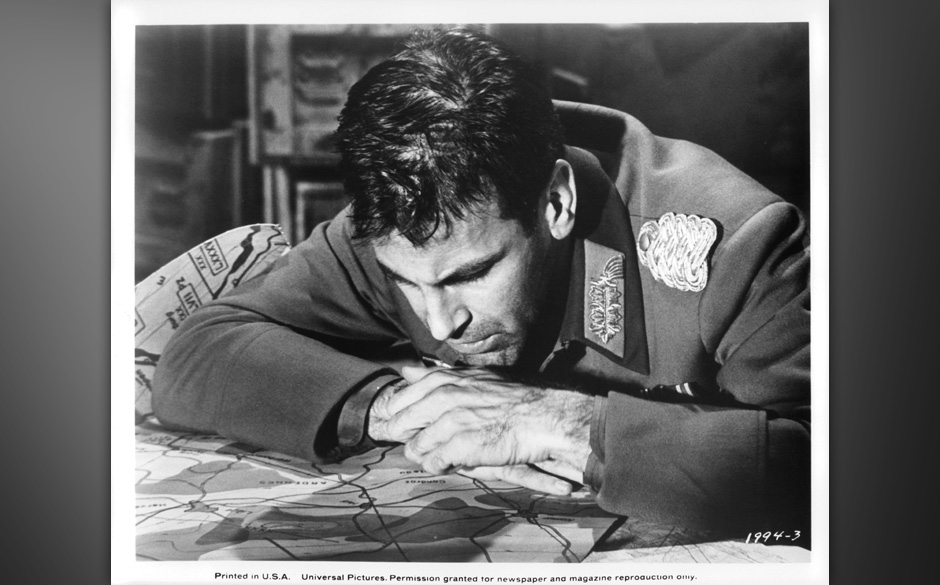 Maximilian Schell looks closely at his maps in a scene from the film 'Counterpoint', 1967. (Photo by Universal Pictures/Getty
