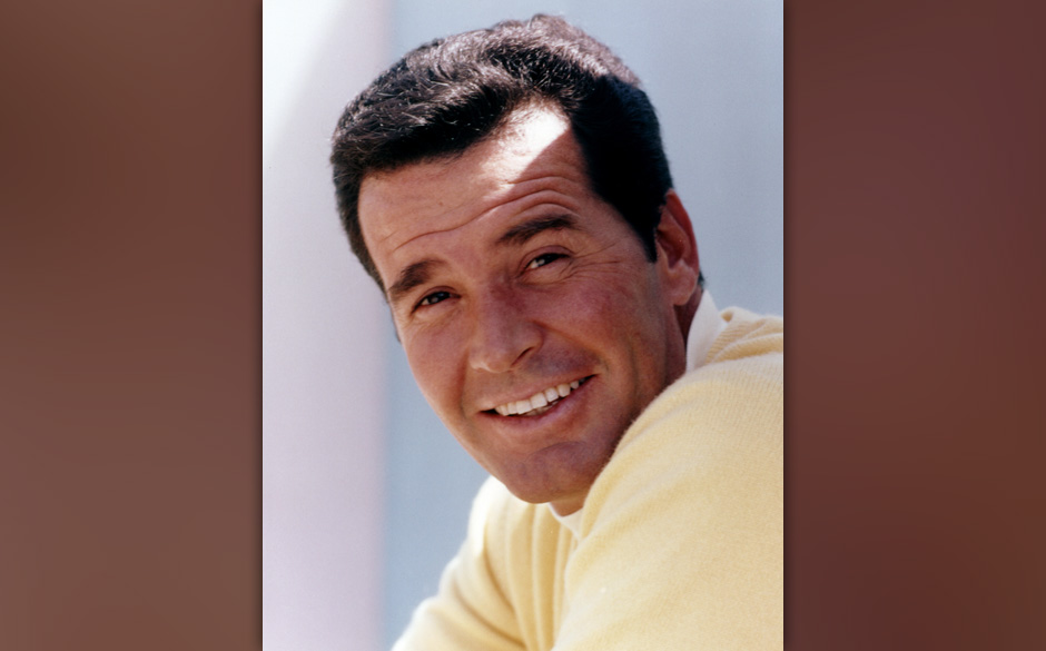Headshot of James Garner, US actor, wearing a lemon-yellow jumper, and smiling, circa 1970. (Photo by Silver Screen Collectio