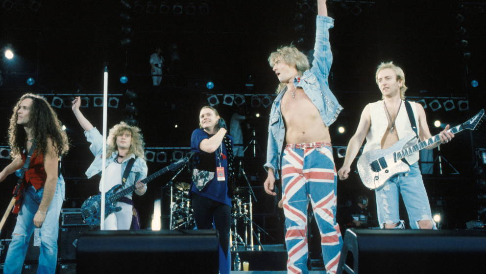 Def Leppard perform on stage at Freddie Mercury Tribute Concert, Wembley, London, 20th April 1992, L-R Vivian Campbell, Rick