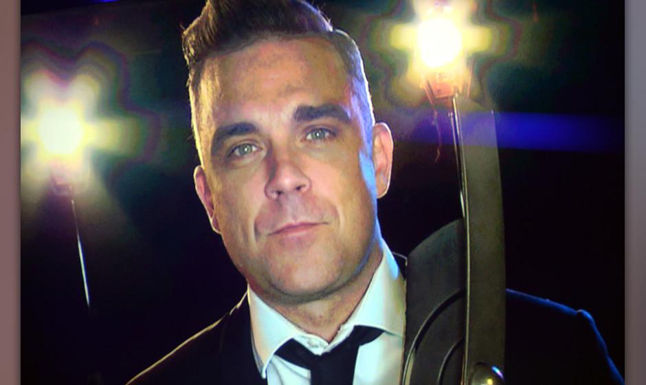 Der britische Musiker Robbie Williams freut sich am 27.03.2014 in Berlin bei der Verleihung des Musikpreises Echo ¸ber die A