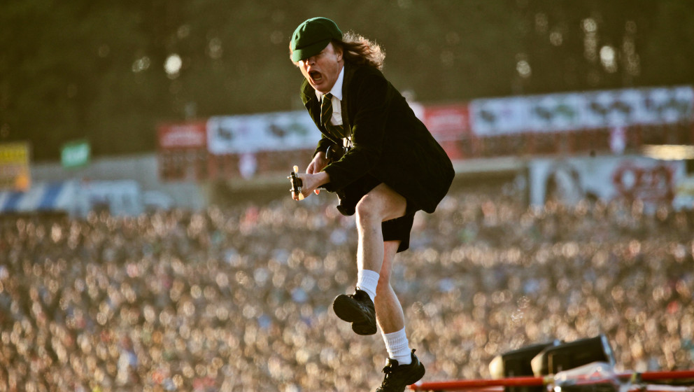 DONINGTON, UK - JUNE 11: A view from the stage showing the audience as Angus Young of AC/DC performs on stage at Download Fes