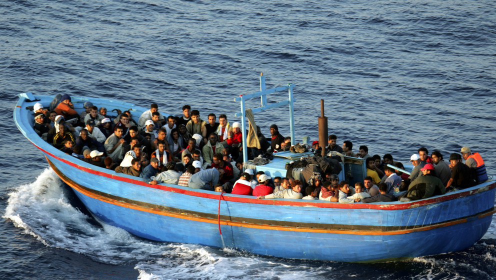 LAMPEDUSA, ITALY - JUNE 21:  A boat loaded with illegal immigrant is seen on  June 21, 2005 in Lampedusa, Italy. Tens of thou