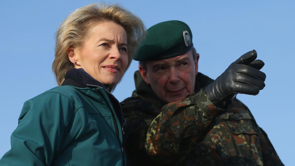 LETZLINGEN, GERMANY - JANUARY 28:  German Defense Minister Ursula von der Leyen observes tanks engaged in military exercises