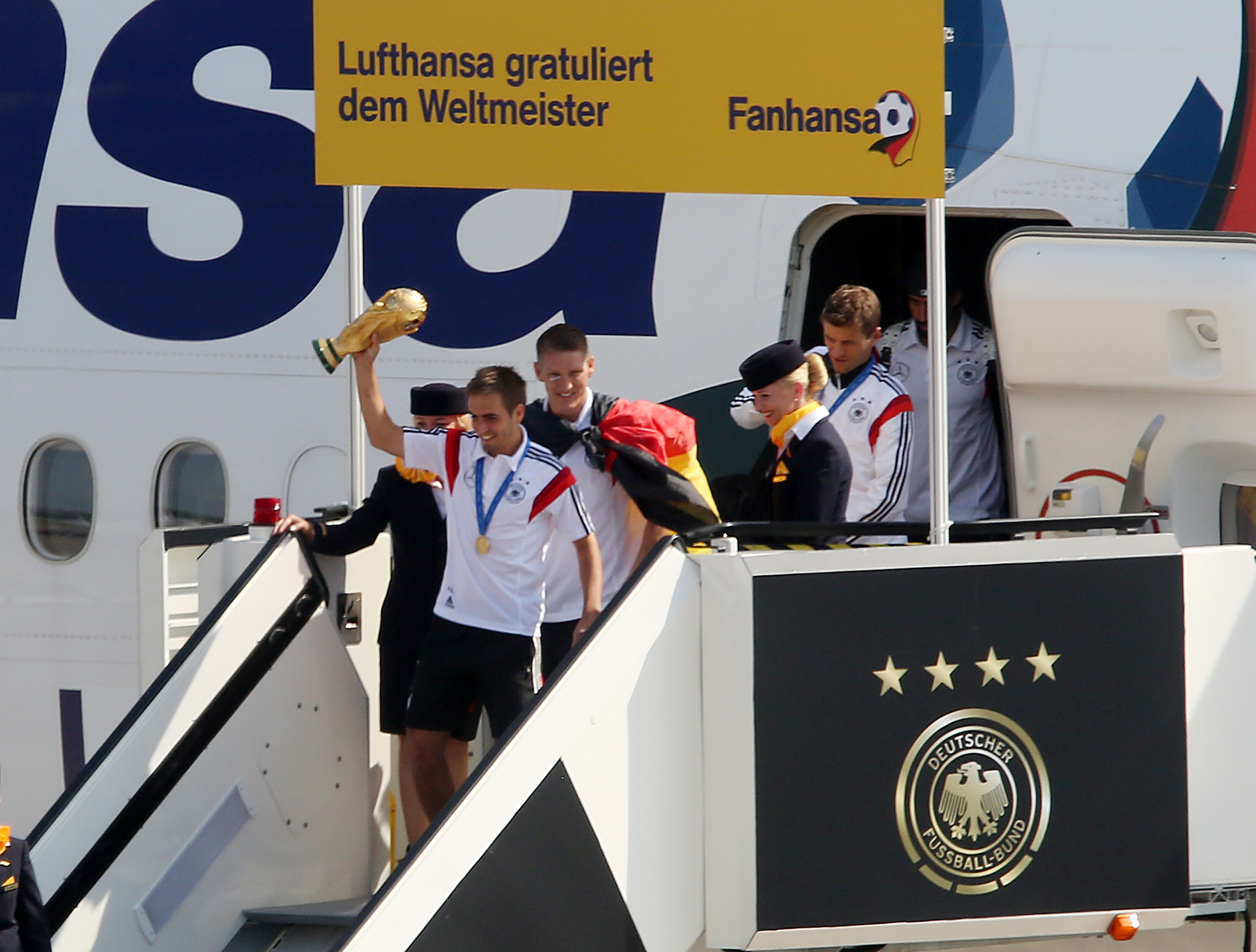 BERLIN, GERMANY - JULY 15:  Team Germany arrives at Berlin after winning the 2014 FIFA World Cup Brazil final against Argenti