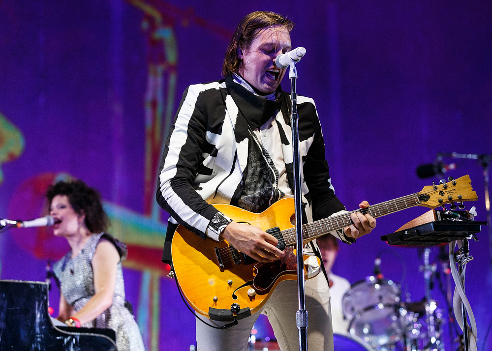 SQUAMISH, BC - AUGUST 09:  Singer Win Butler of Arcade Fire performs on stage during Day 2 of Squamish Valley Music Festival