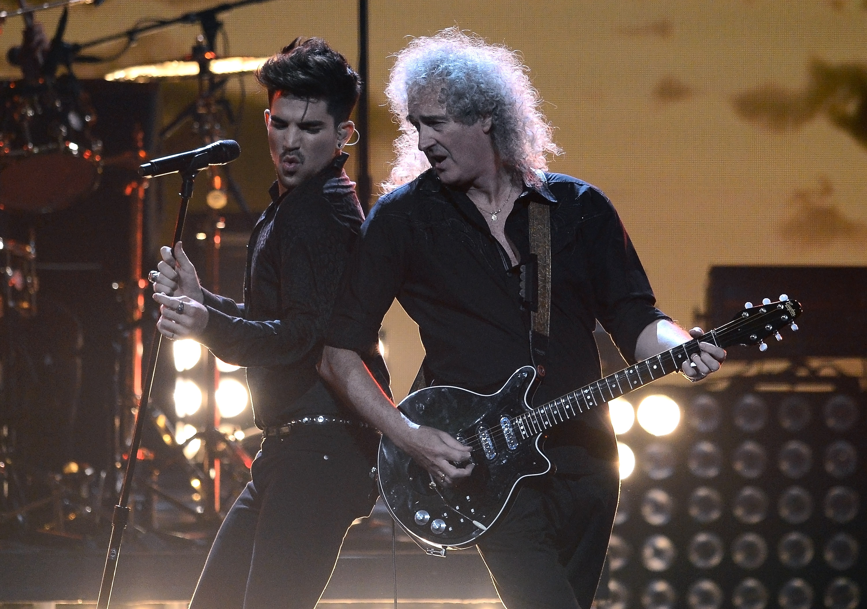 LAS VEGAS, NV - SEPTEMBER 20:  Singer Adam Lambert (L) and guitarist Brian May of Queen perform during the iHeartRadio Music