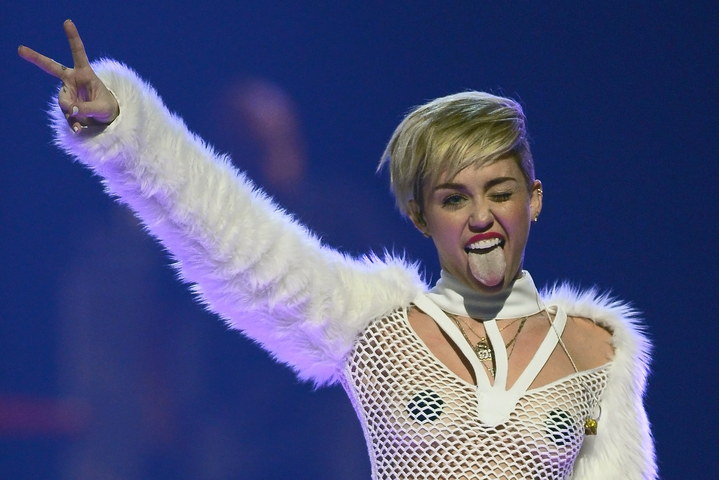 LAS VEGAS, NV - SEPTEMBER 21:  Entertainer Miley Cyrus winks and sticks out her tongue as she performs during the iHeartRadio