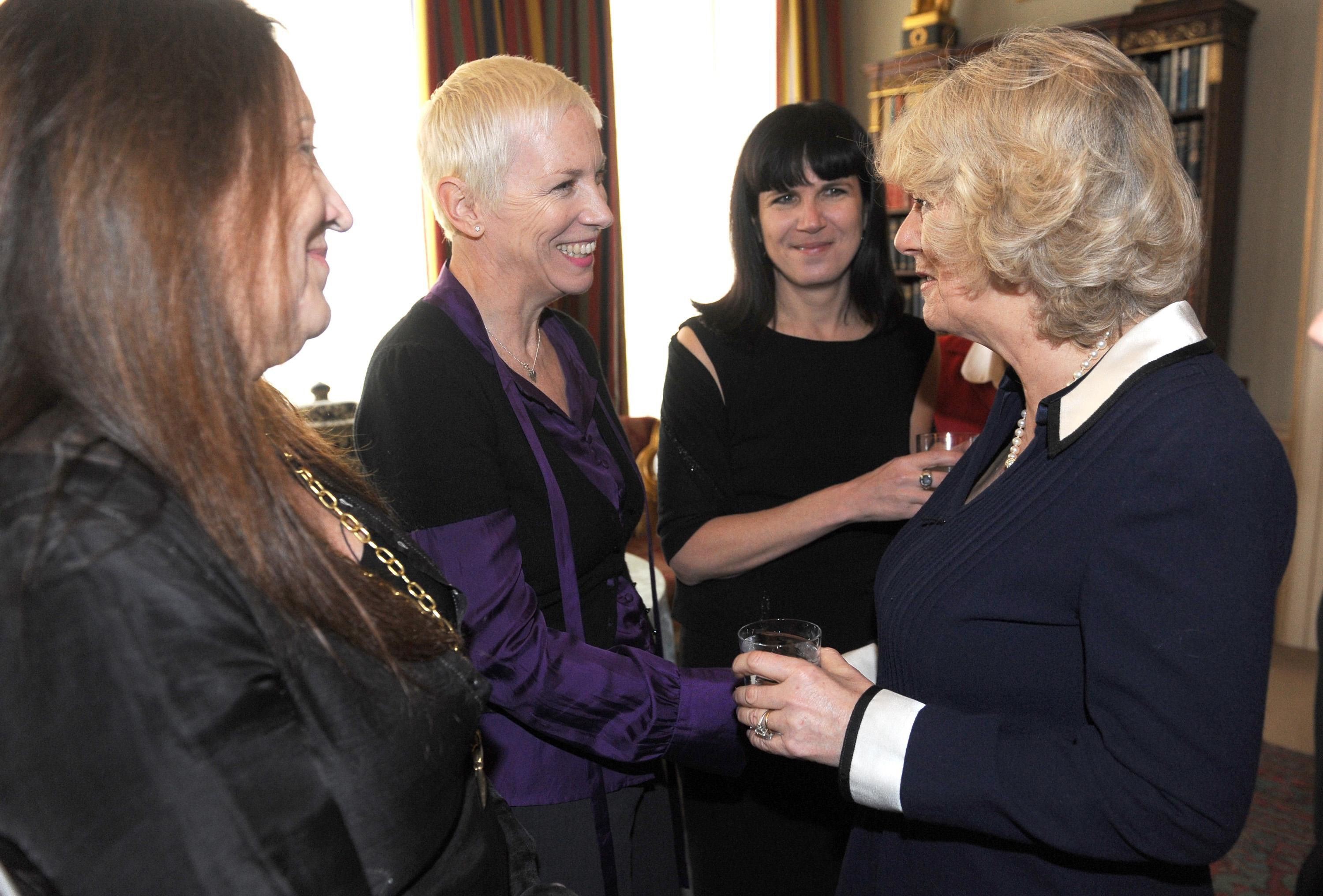 Duchess of Cornwall launches Women of the World Festival.The Duchess of Cornwall speaks to Annie Lennox (second left) at a re