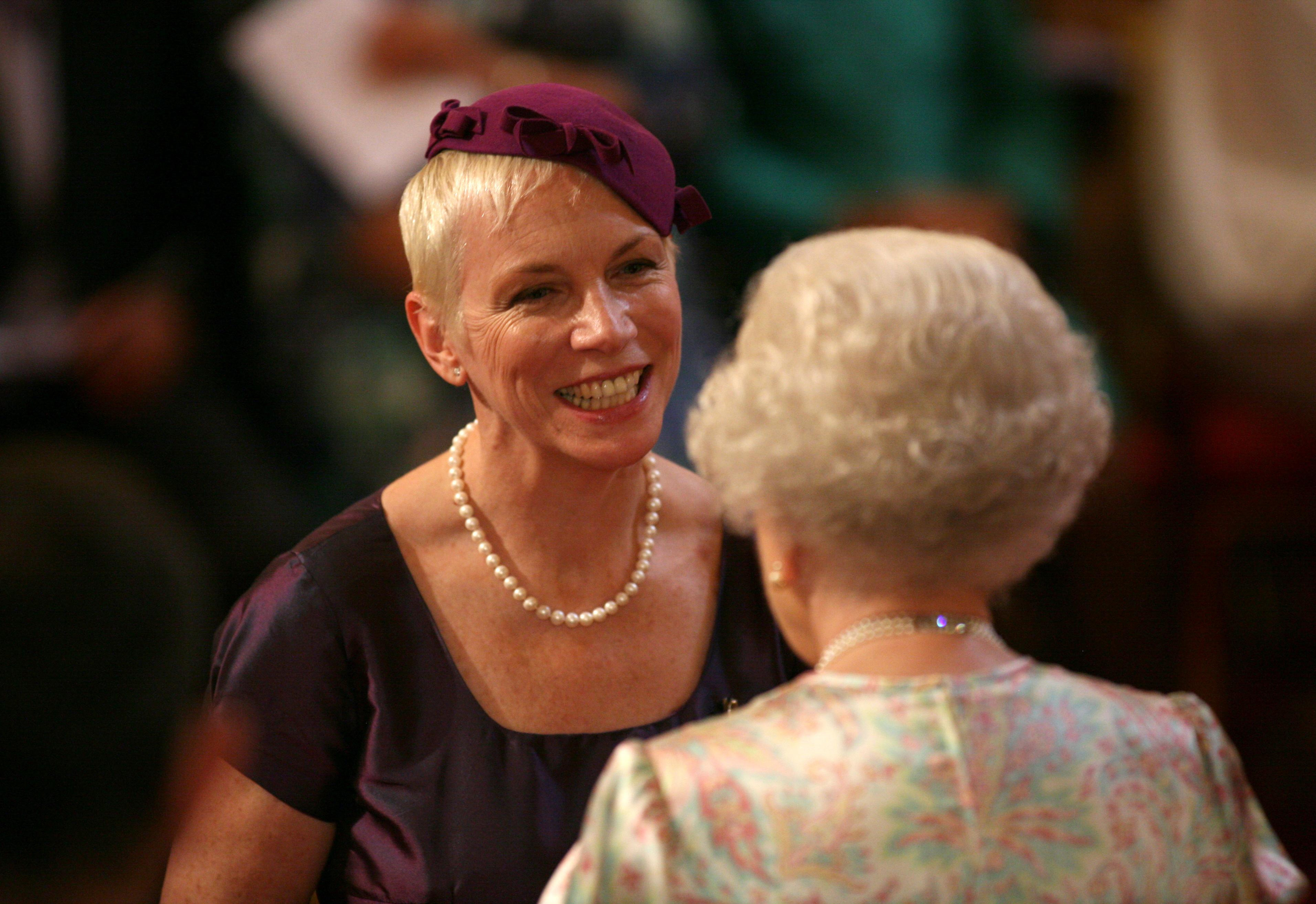 Investitures at Buckingham Palace. Annie Lennox is made a an OBE by Queen Elizabeth II at Buckingham Palace, London. Picture