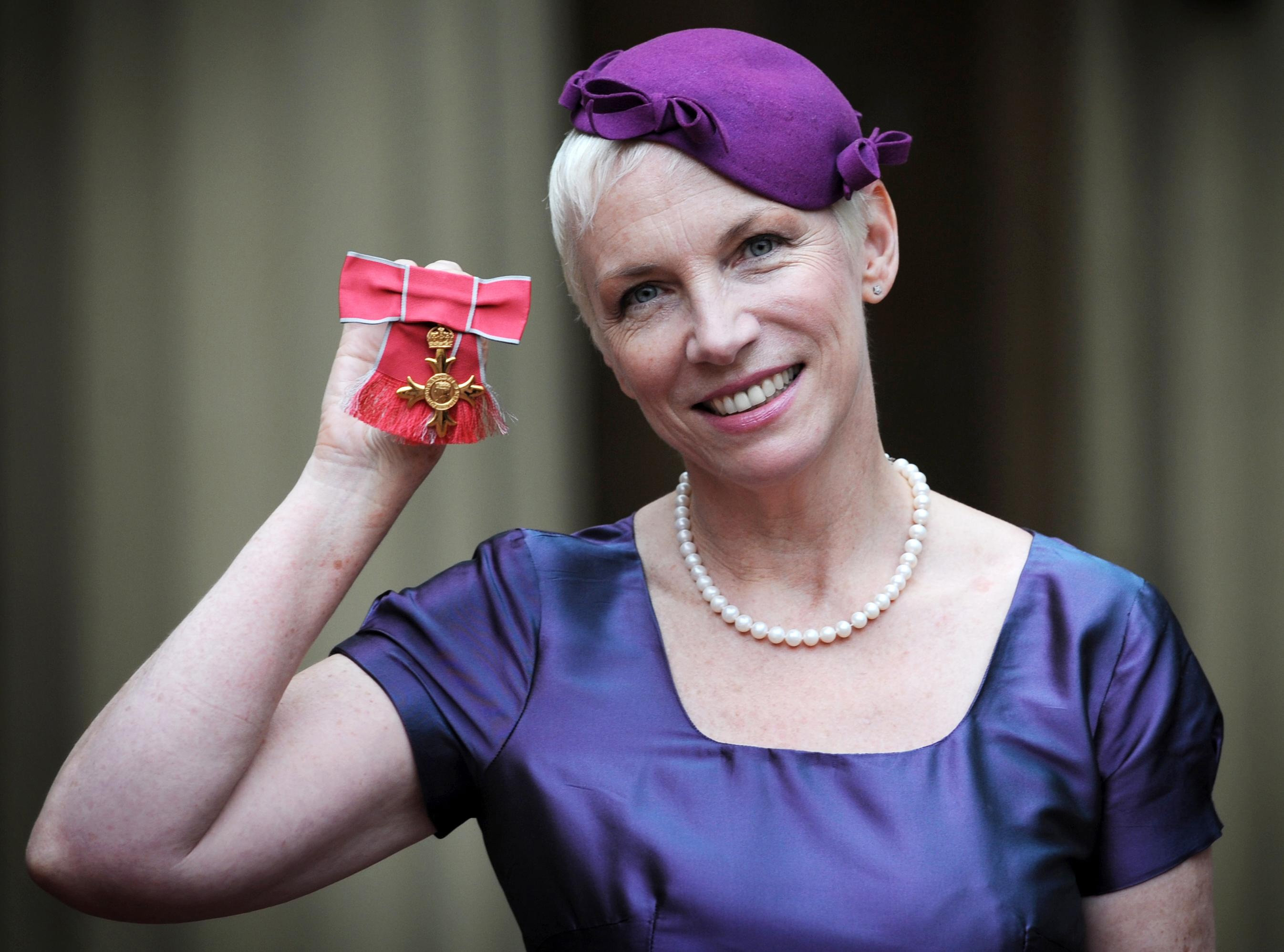 Investitures at Buckingham Palace. Musician Annie Lennox poses with her OBE which she received from Queen Elizabeth II at Buc