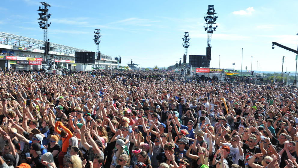 NUERBURG, GERMANY - JUNE 06: Spectators celebrate in front of the centerstage during the second day of 'Rock am Ring'  on Jun