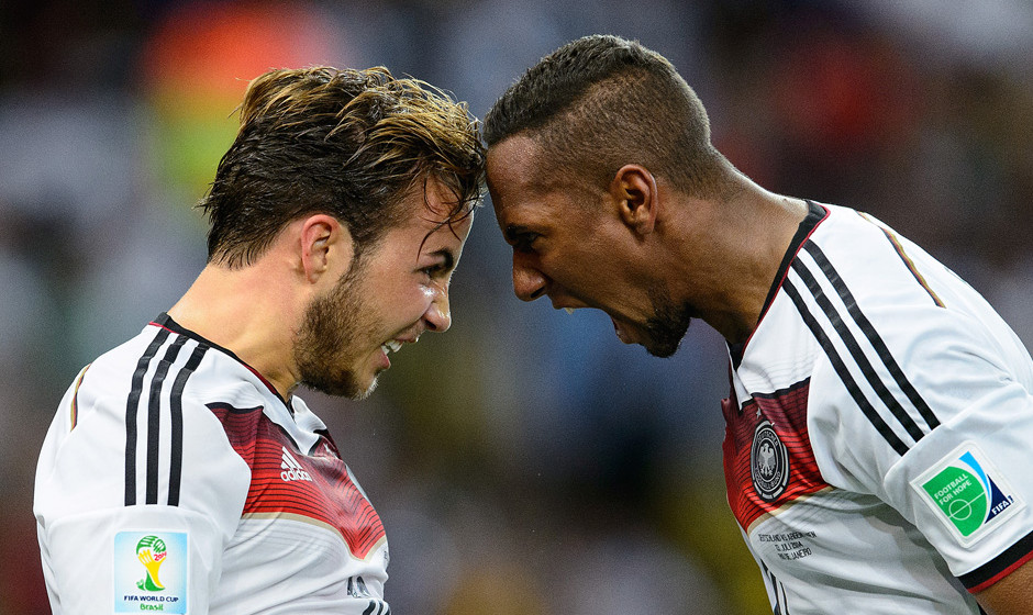 RIO DE JANEIRO, BRAZIL - JULY 13: Mario Goetze of Germany (L) celebrates scoring his team's first goal with Jerome Boateng du