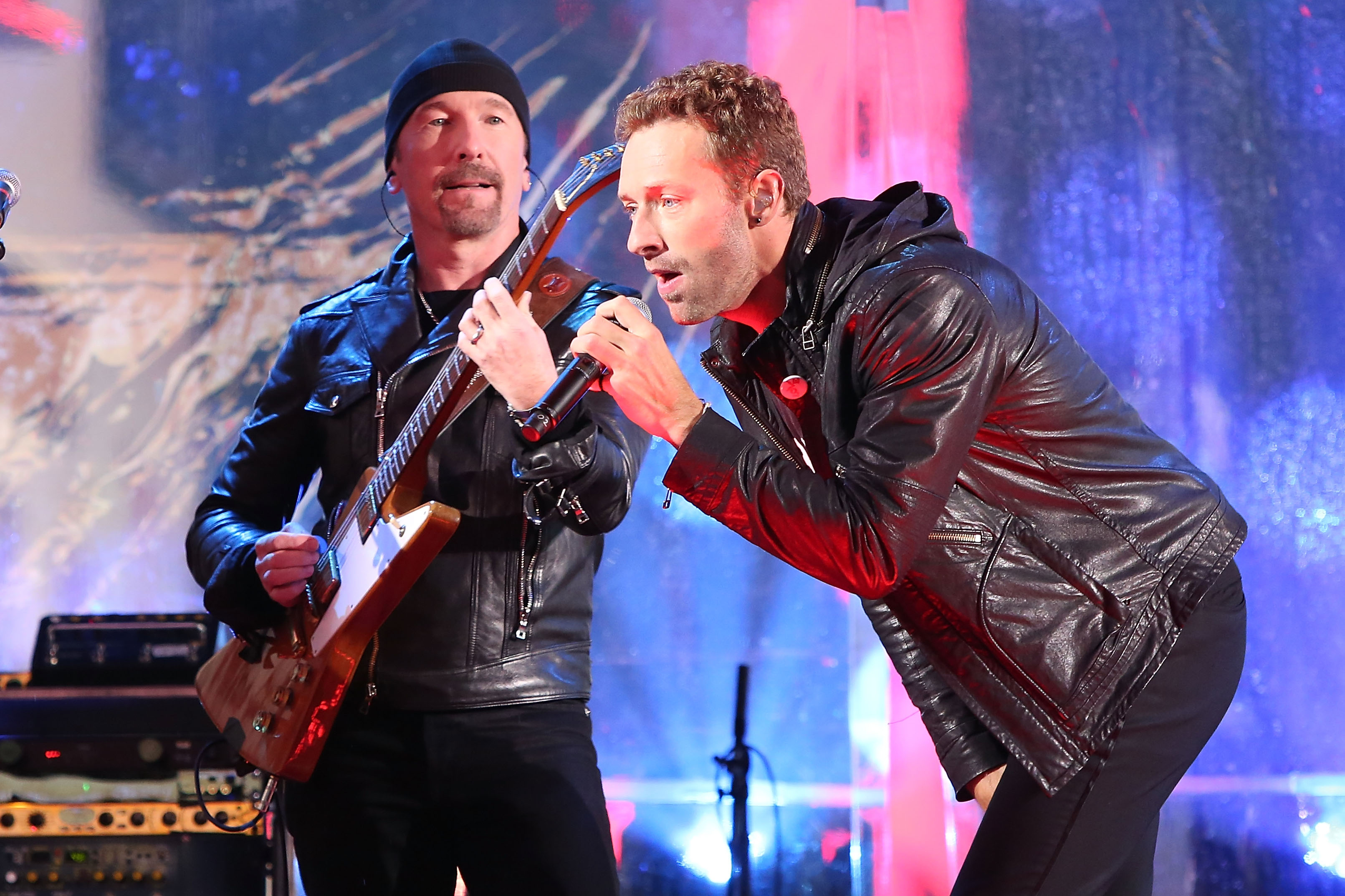 NEW YORK, NY - DECEMBER 01:  The Edge and Chris Martin of Coldplay perform as 'U2 - 1' in a surprise concert by (RED) to mark