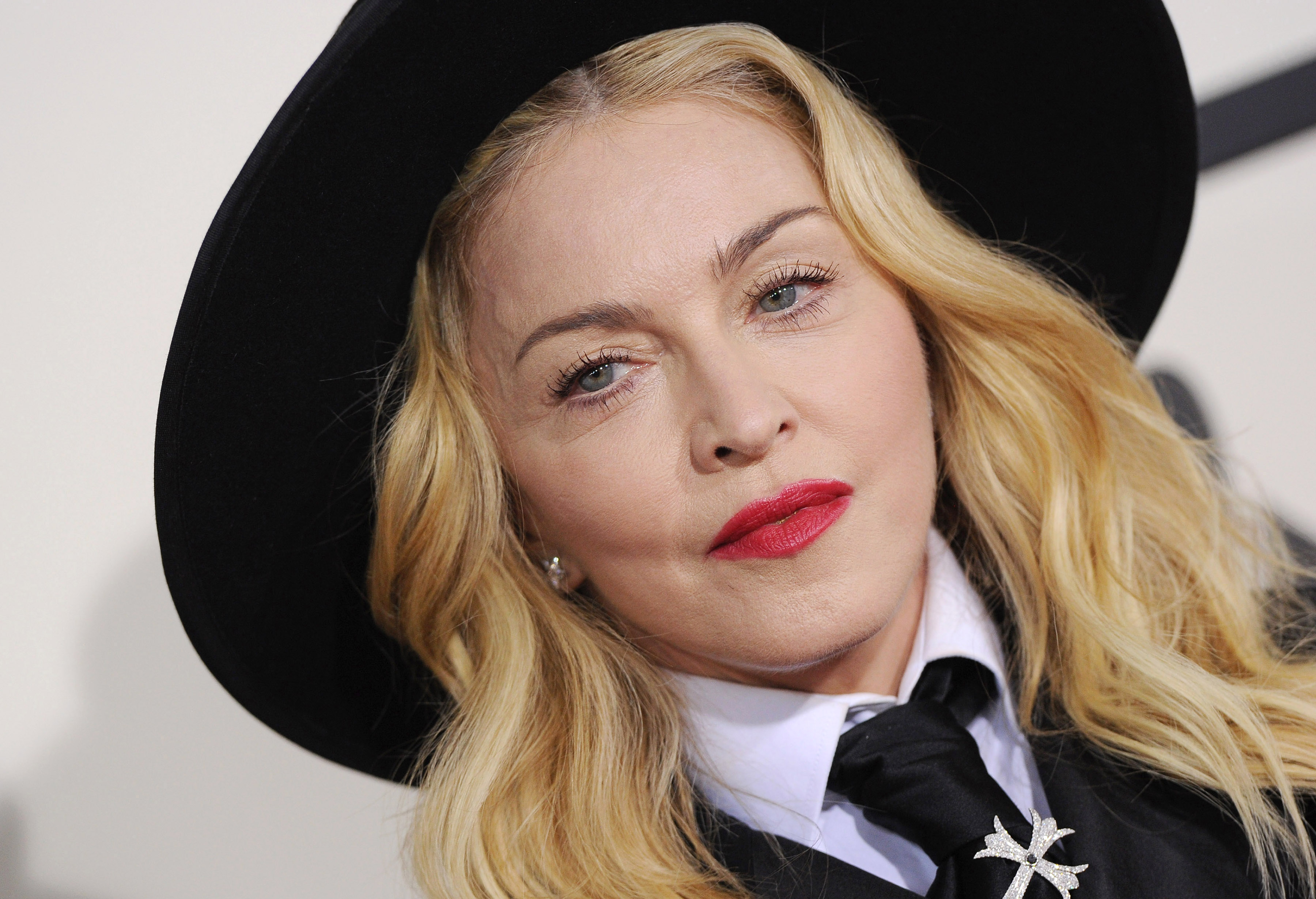 LOS ANGELES, CA - JANUARY 26:  Singer Madonna arrives at the 56th GRAMMY Awards at Staples Center on January 26, 2014 in Los