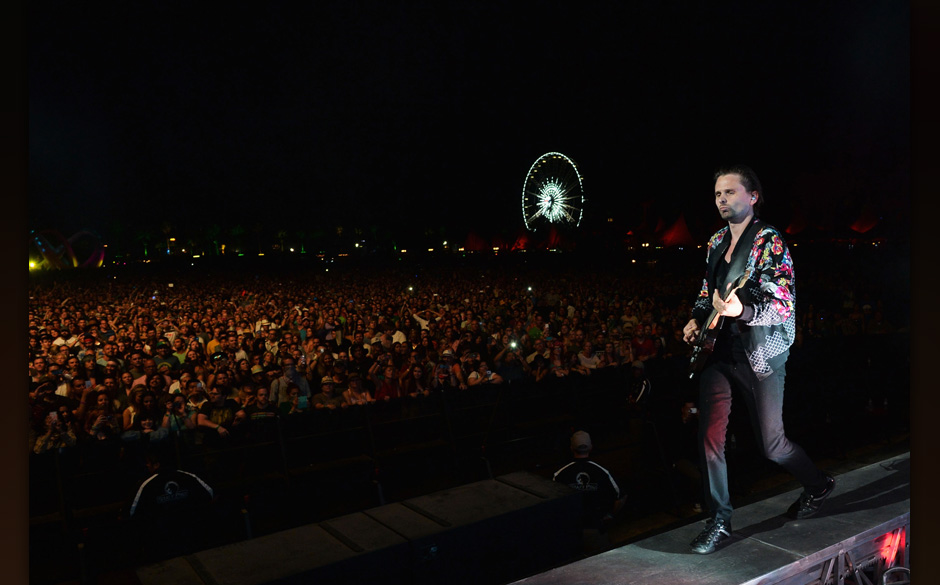 INDIO, CA - APRIL 19:  Musician Matthew Bellamy of Muse performs onstage during day 2 of the 2014 Coachella Valley Music &amp