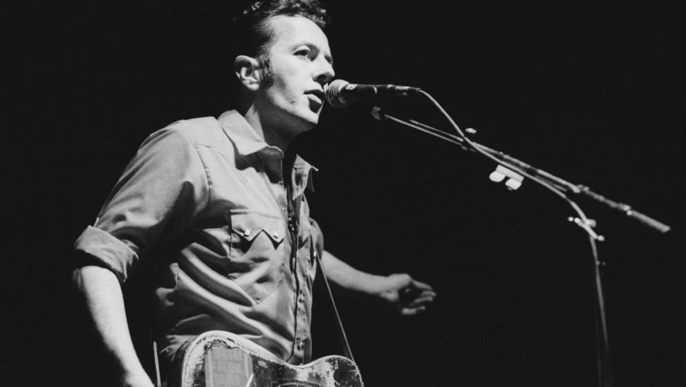 Singer Joe Strummer (1952 ? 2002), formerly of British punk band The Clash, performing with his band Latino Rockabilly War at