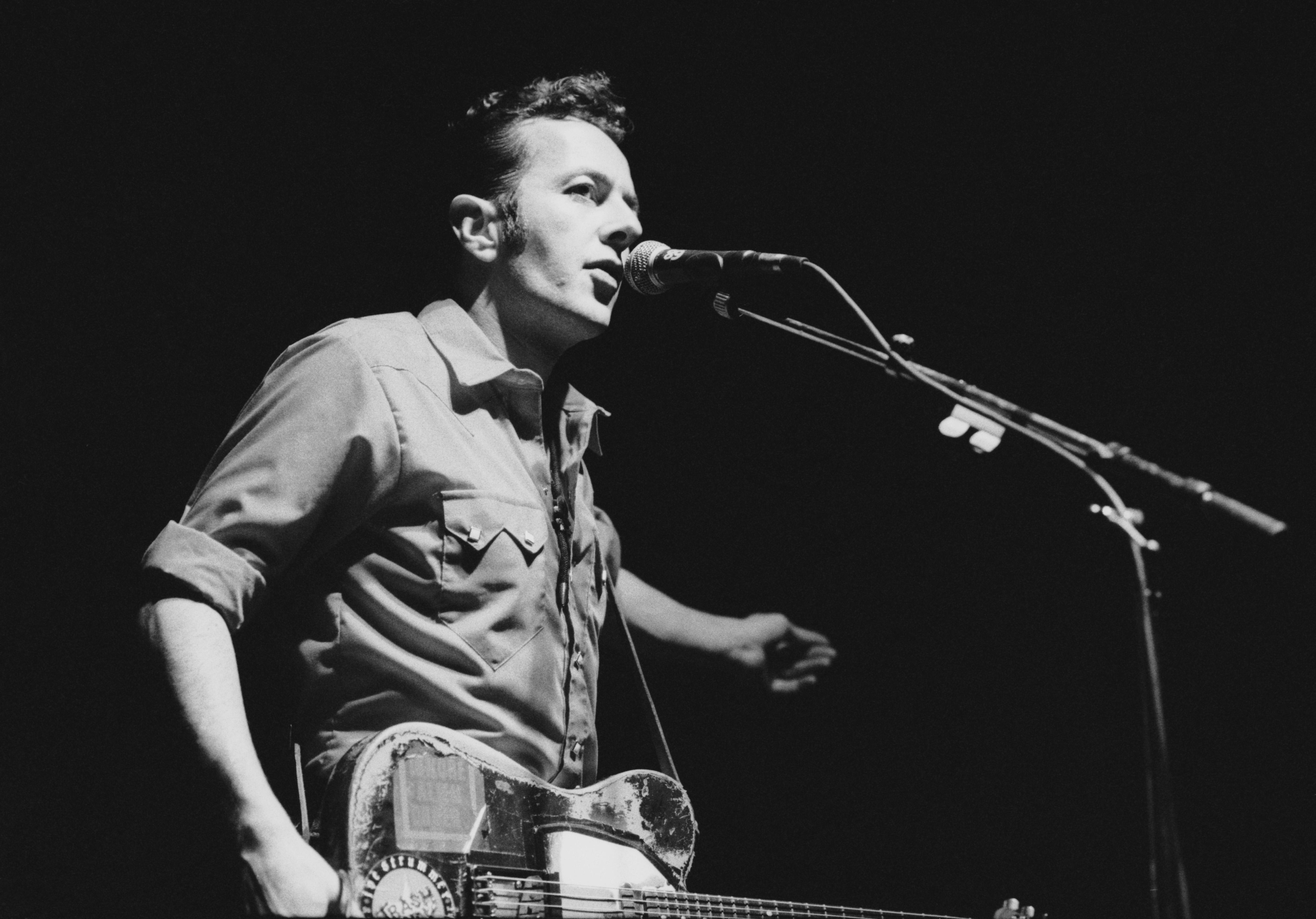 Singer Joe Strummer (1952 ? 2002), formerly of British punk band The Clash, performing with his band Latino Rockabilly War at