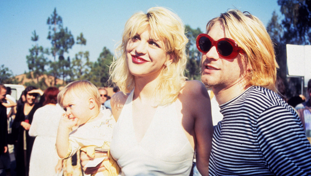 Kurt Cobain of Nirvana (right) with wife Courtney Love and daughter Frances Bean Cobain (Photo by Terry McGinnis/WireImage)