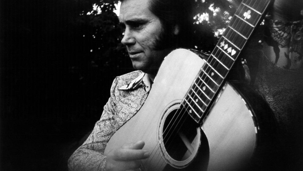 UNSPECIFIED - circa 1975:  Photo of Country musician George JONES posed playing an acoustic guitar circa 1975. (Photo by Gems