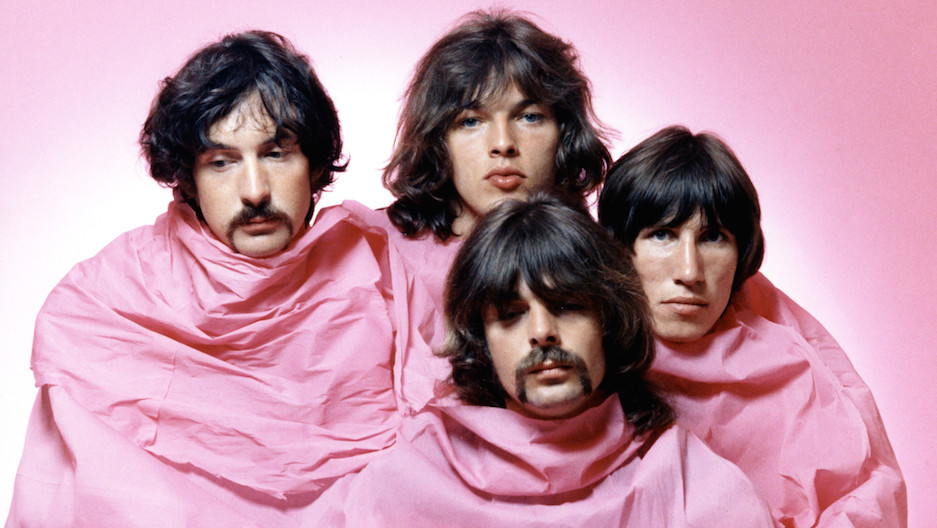 LOS ANGELES - AUGUST 1968: Psychedelic rock group Pink Floyd pose for a portrait shrouded in pink in August of 1968 in Los An